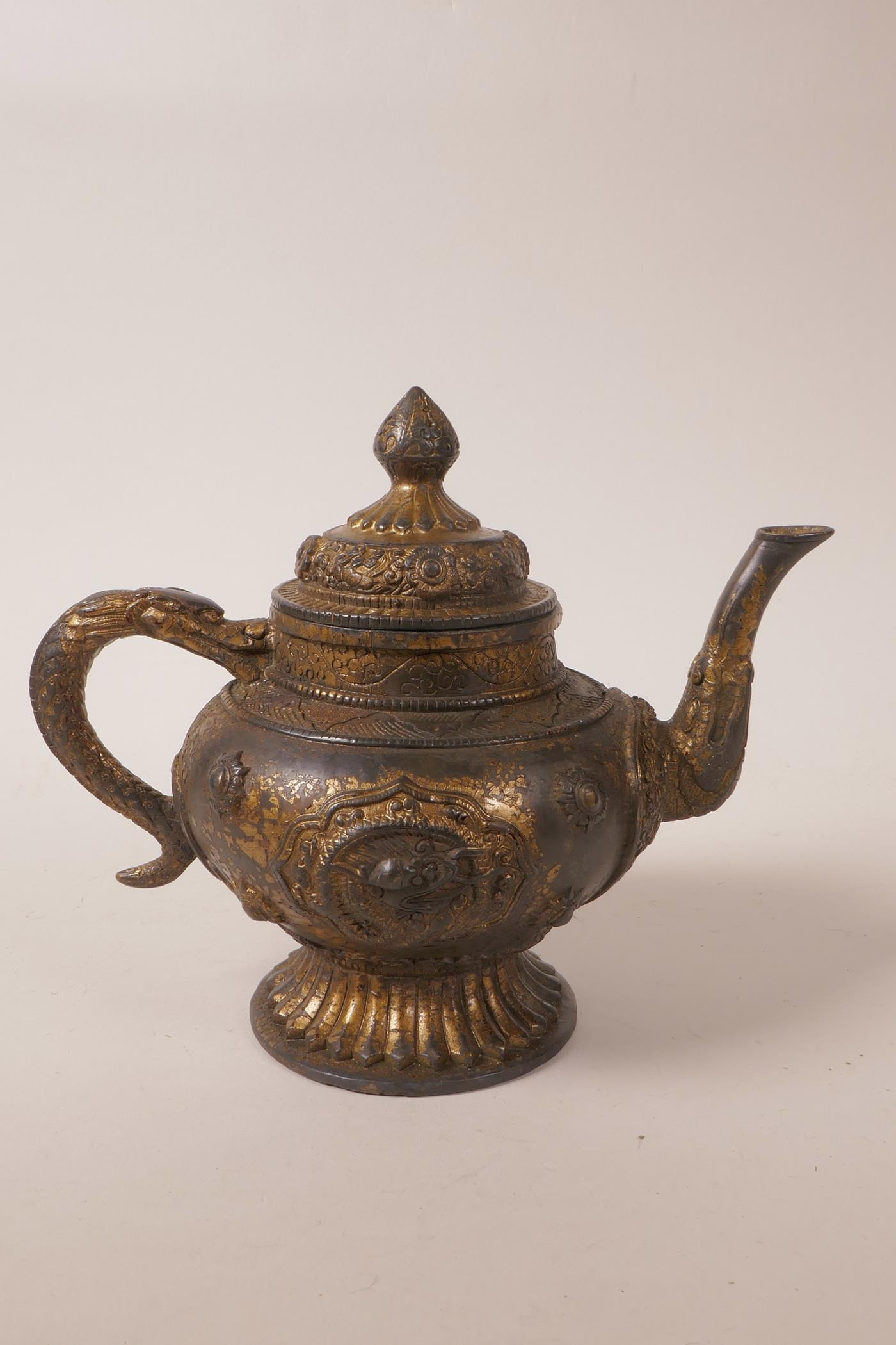 Lot 35 - A Chinese gilt and bronzed metal teapot with raised dragon and floral decoration, mark to base,
