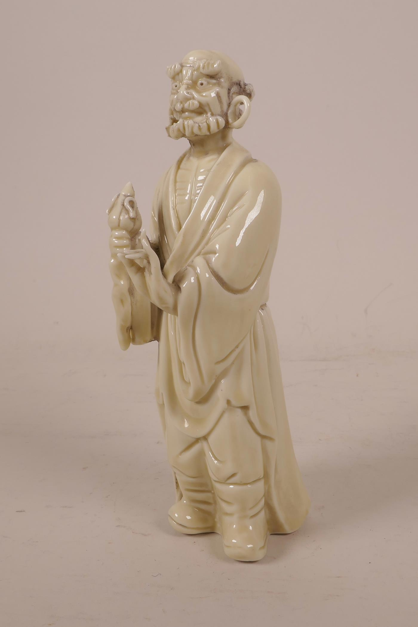 "Lot 31 - A Chinese blanc de chine figure of Lohan, impressed marks verso, 7"" high"