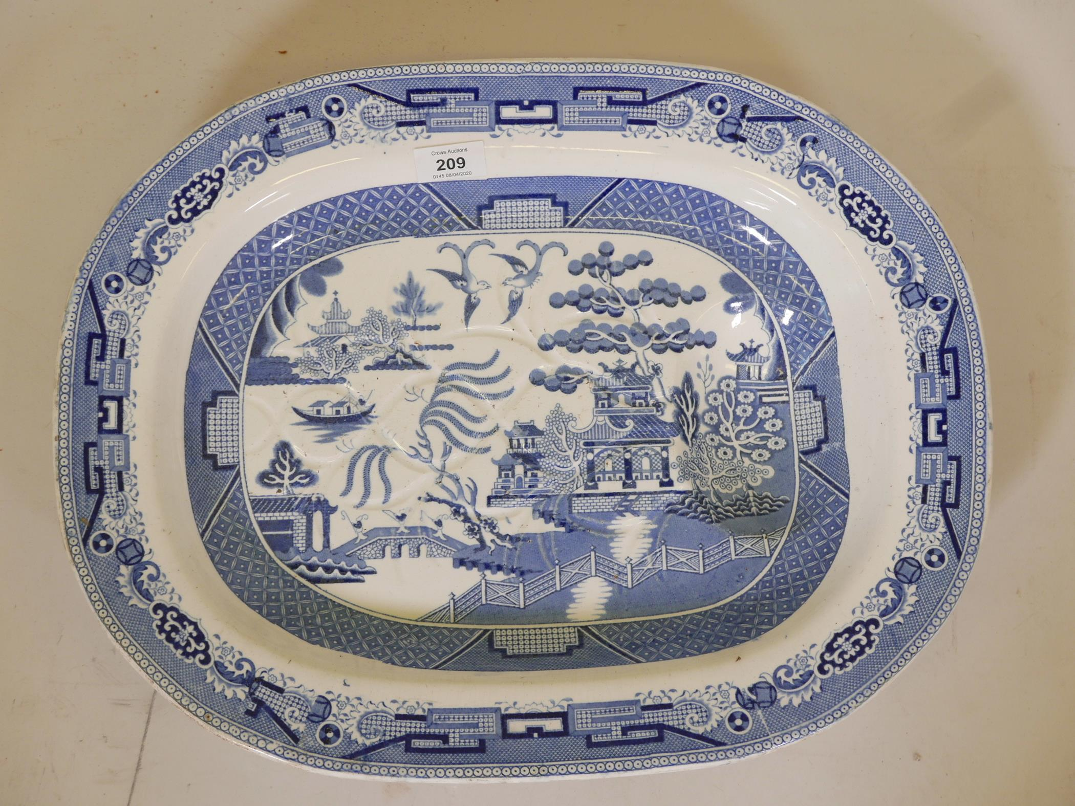 Lot 209 - A Victorian Staffordshire blue and white transfer printed meat dish, marked Cartwright and