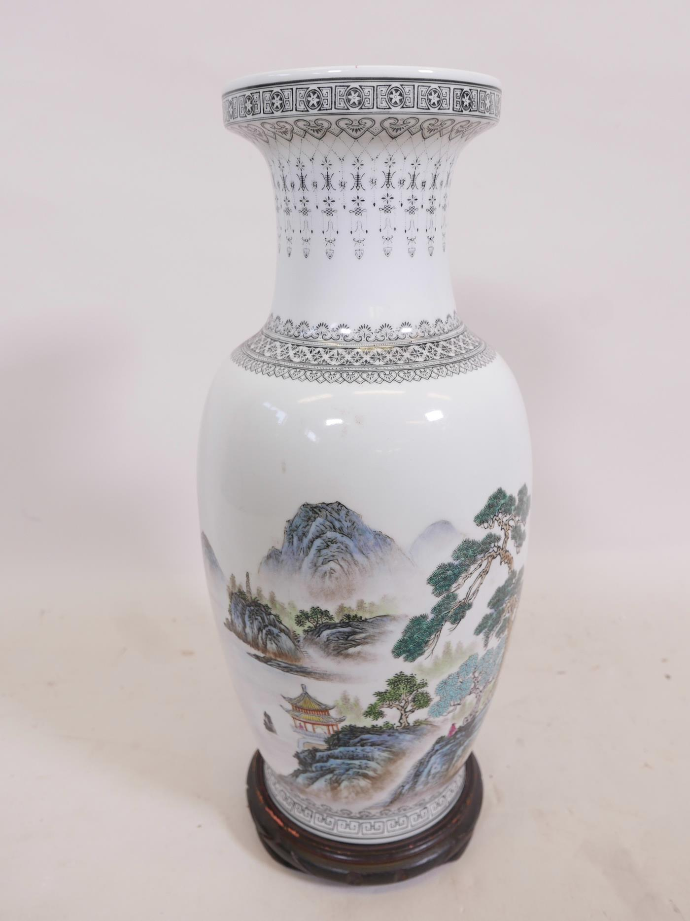 Lot 12 - A Chinese Republic porcelain vase decorated with figures in a forest and lake landscape, calligraphy