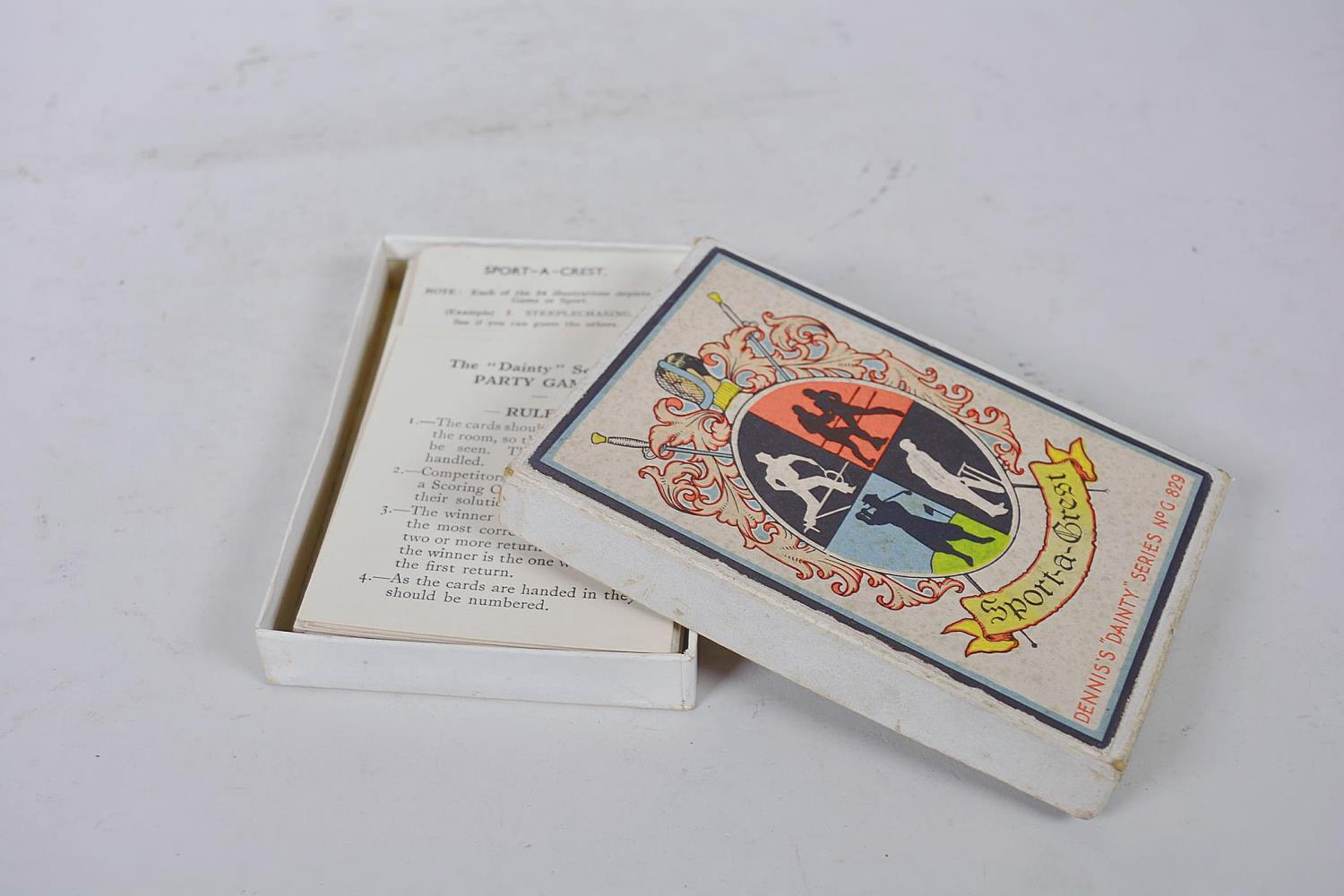Lot 4 - A small collection of vintage games and playing cards including Beetle Game, Sport a Crest,