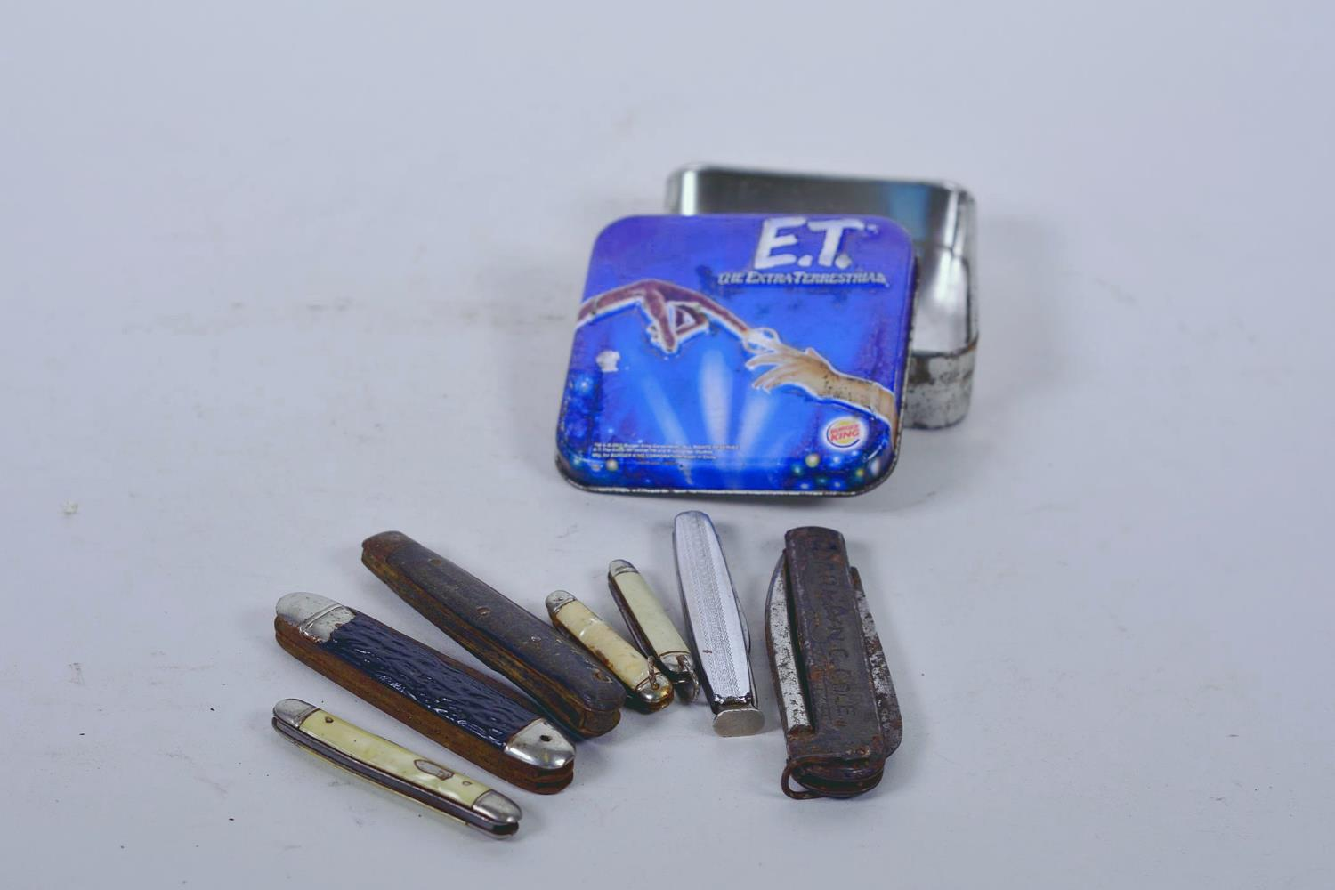 Lot 3 - A collection of seven various penknives in a Burger King 'ET' collector's tin