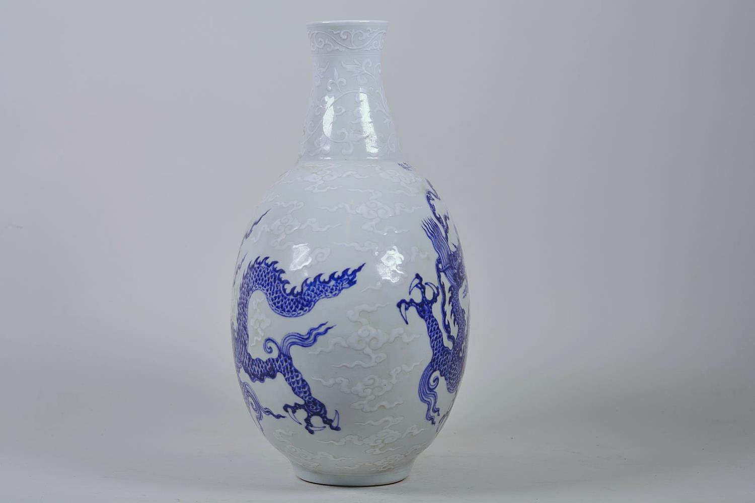 """Lot 28 - A Chinese blue and white moon flask with dragon decoration, 6 character mark to side, 12½"""" high"""