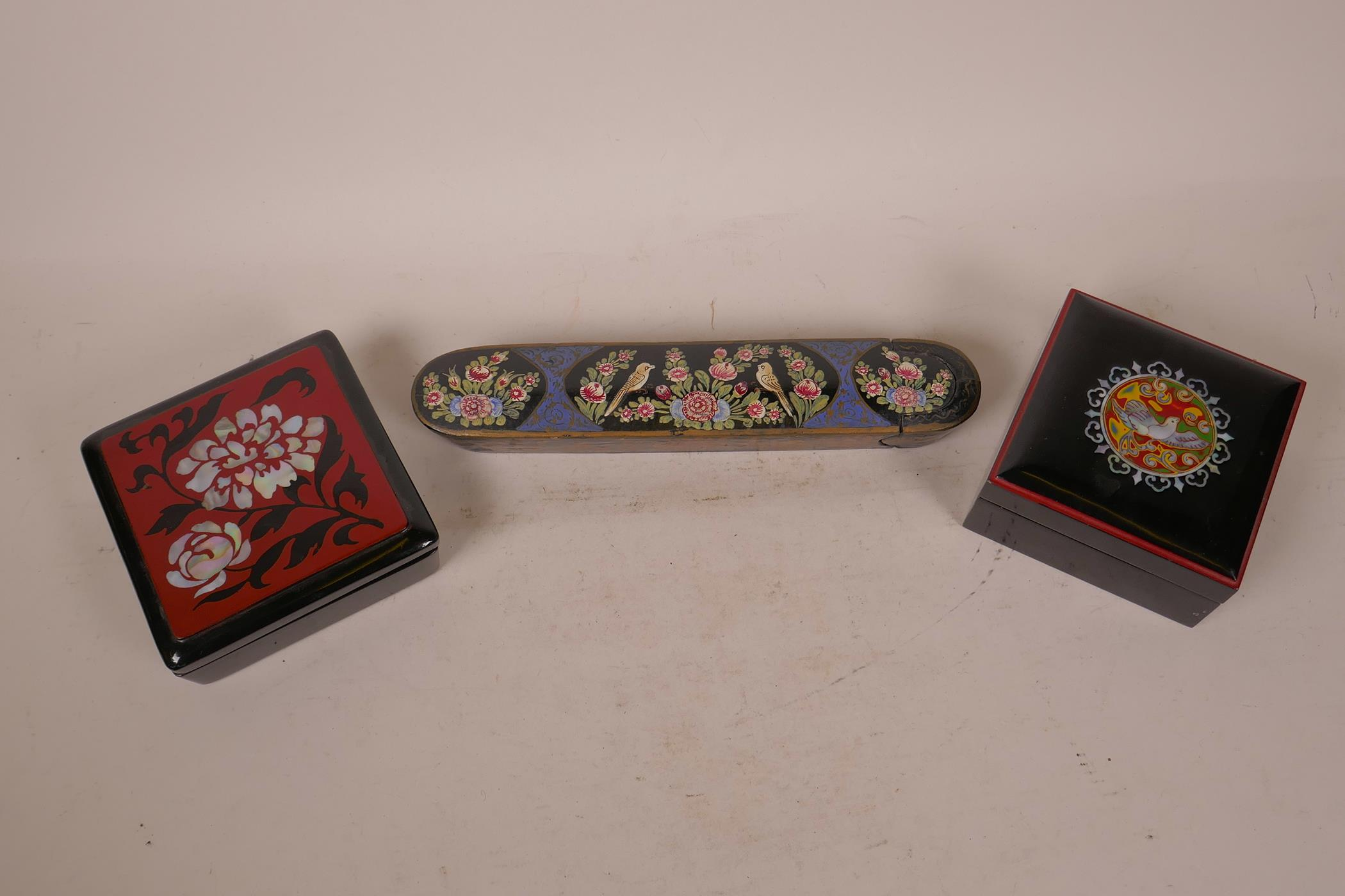 """Lot 2 - A Kashmiri papier mache scribe's box hand painted with birds and flowers, 10"""" long, together with"""