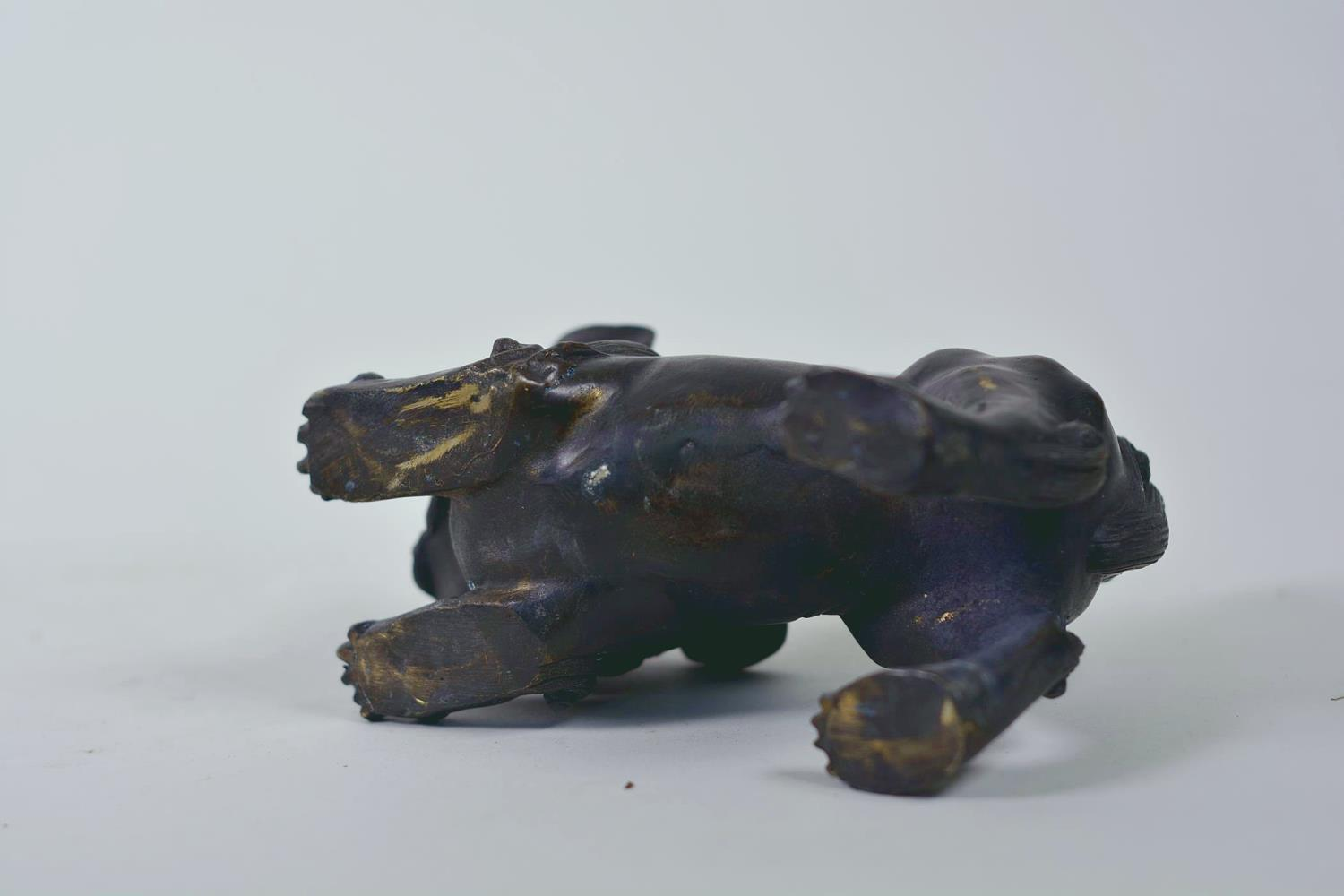 """Lot 19 - A pair of Oriental patinated bronze figures of fo dogs, 6"""" long"""