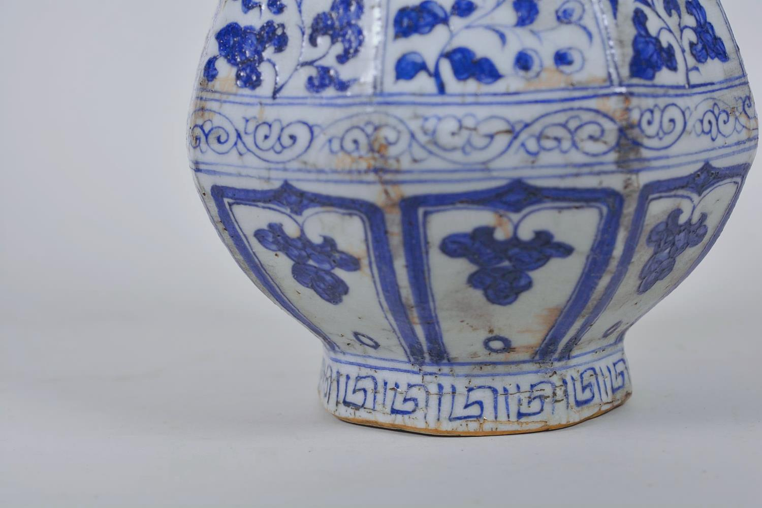 "Lot 23 - A Chinese Ming style blue and white pottery pear shaped vase decorated with flowers, 12"" high"