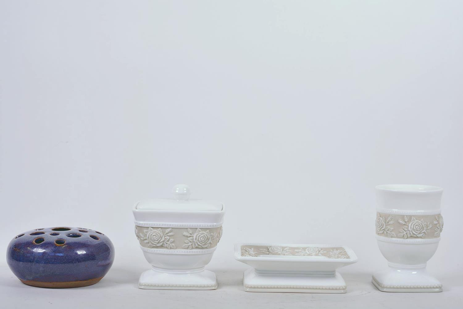 Lot 27 - A Swedish porcelain dressing table trio of trinket box, pin tray and vase with embossed floral
