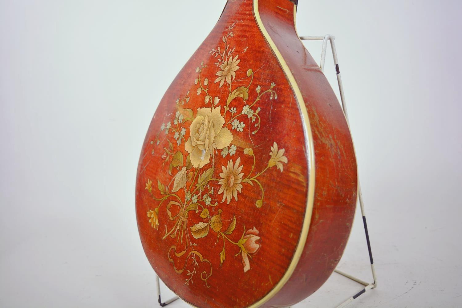 """Lot 1 - A vintage flat back mandolin with rosewood finger board and floral painted decoration, 24"""" long,"""
