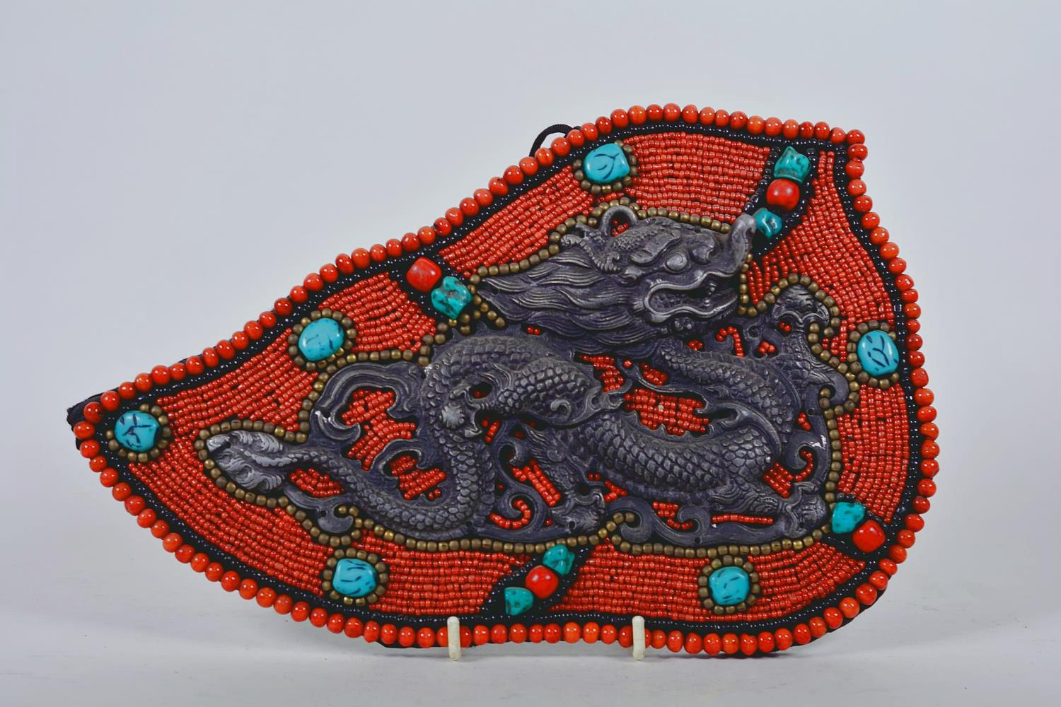 "Lot 8 - A Tibetan wall hanging decorated with agate, coral and turquoise beads, 13"" x 8"""