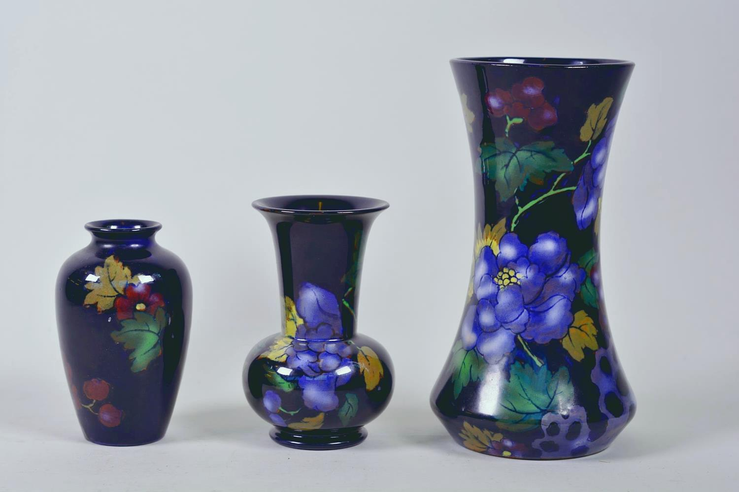 "Lot 29 - Three 'Royal Stanley' red earthenware vases painted in the 'Jacobean' pattern, largest 8"" high"