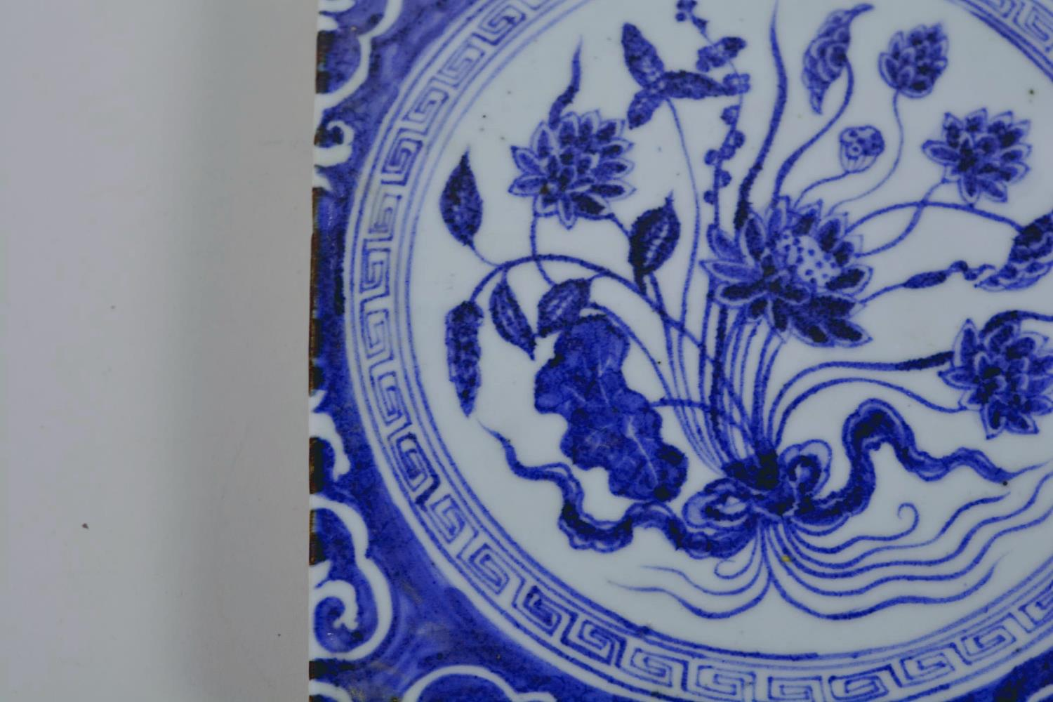 """Lot 20 - A Chinese blue and white porcelain tile decorated with flowers, 8"""" x 8"""""""