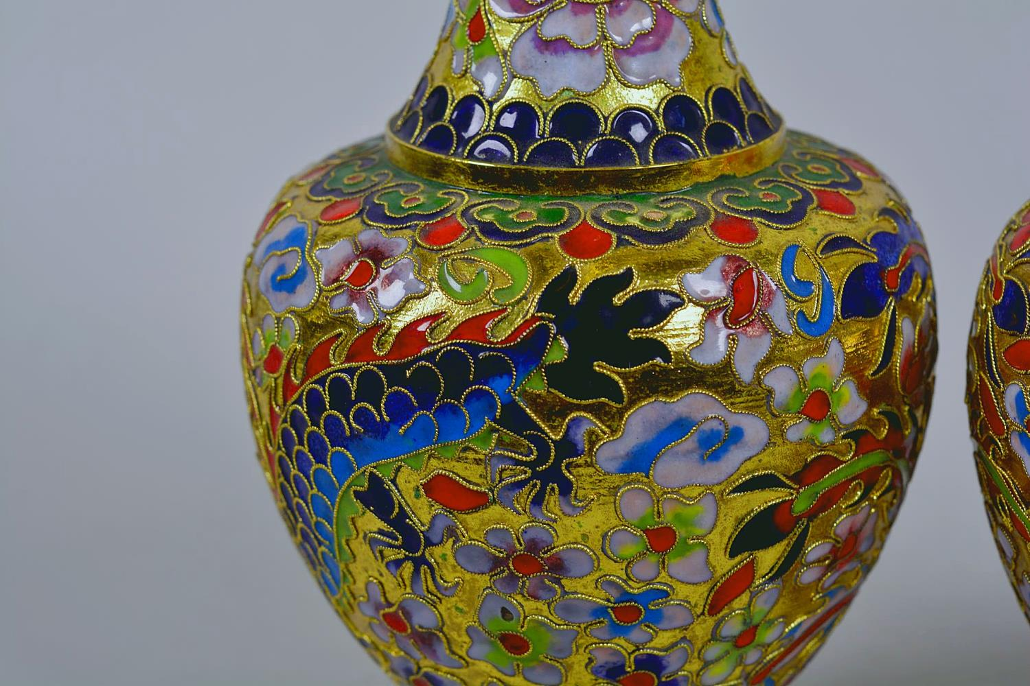 """Lot 24 - A pair of Oriental cloisonné vases decorated with dragons, 8"""" high"""