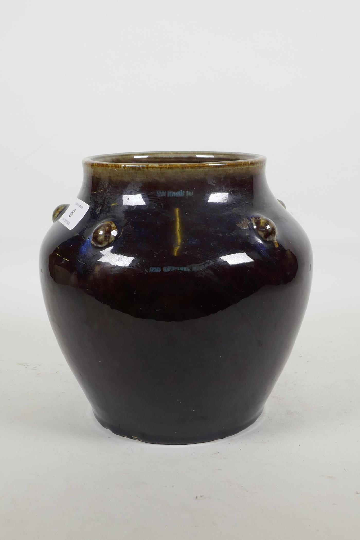 Lot 6 - A Chinese porcelain purple flambé glazed vase with embossed decoration to the shoulders, mark to