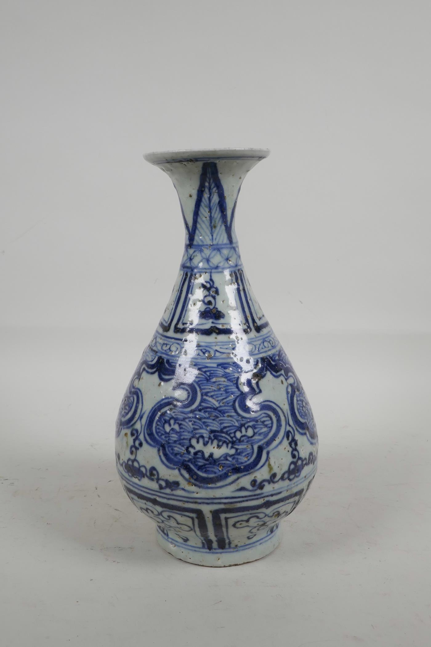 Lot 24 - A Chinese blue and white porcelain pear shaped vase with flared rim and stylised decoration, 10""