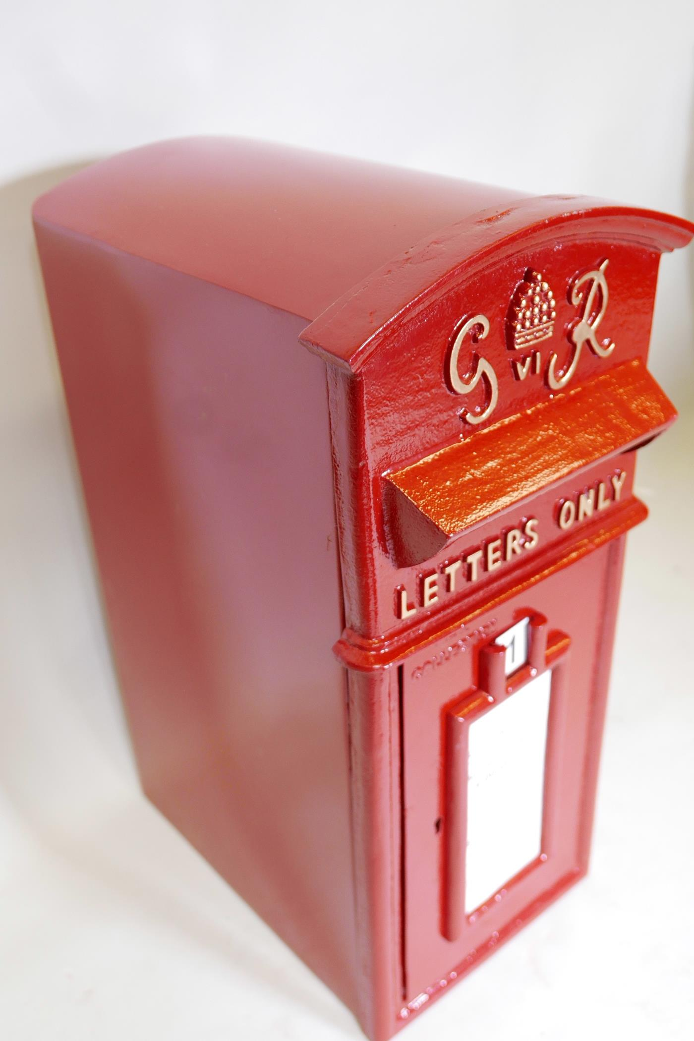 """Lot 17 - A cast iron and metal postbox with key, 23"""" x 14½"""" x 11"""""""