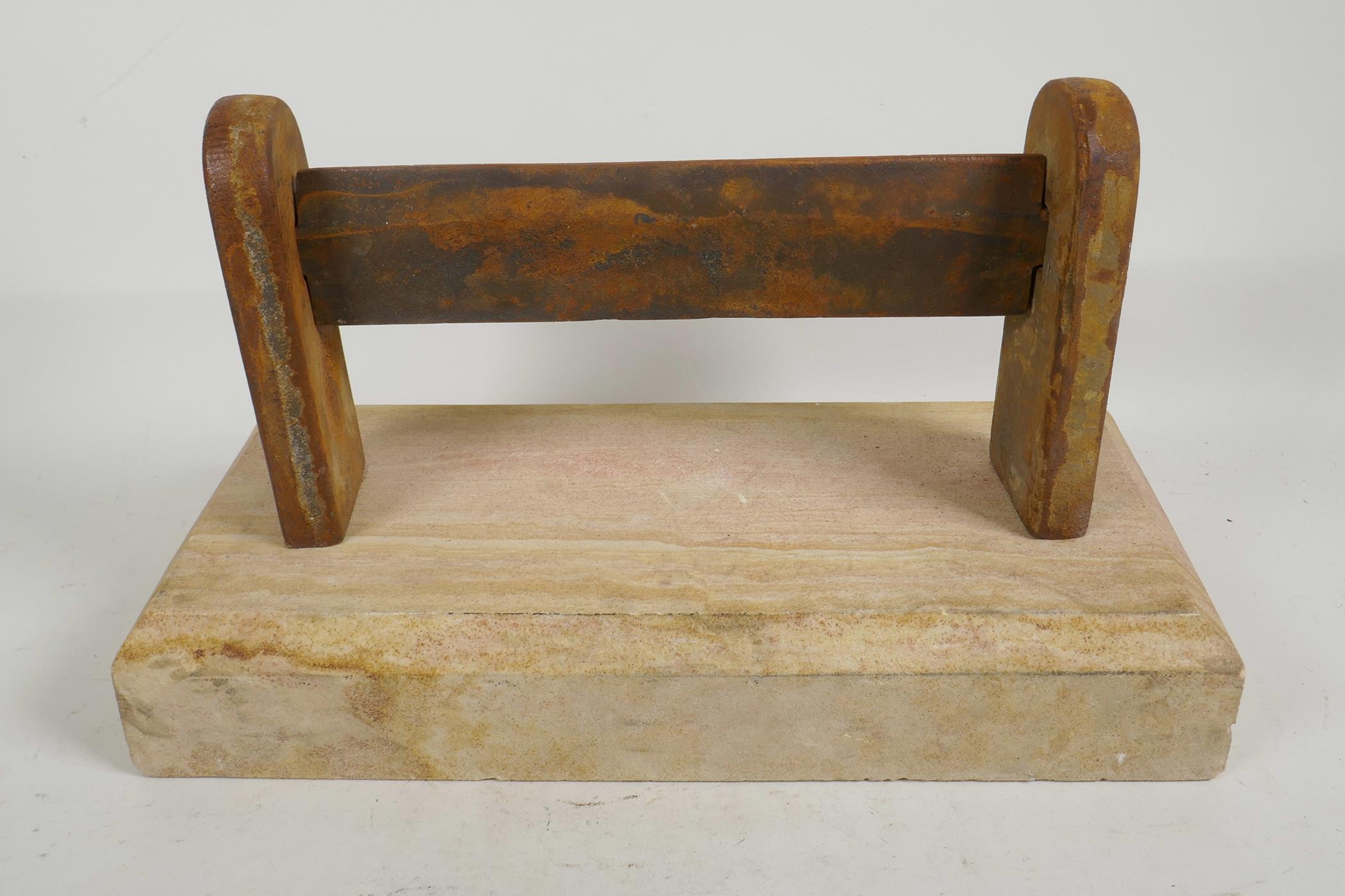 "Lot 9 - A cast iron boot scraper set on a sandstone base, 15"" x 7½"""