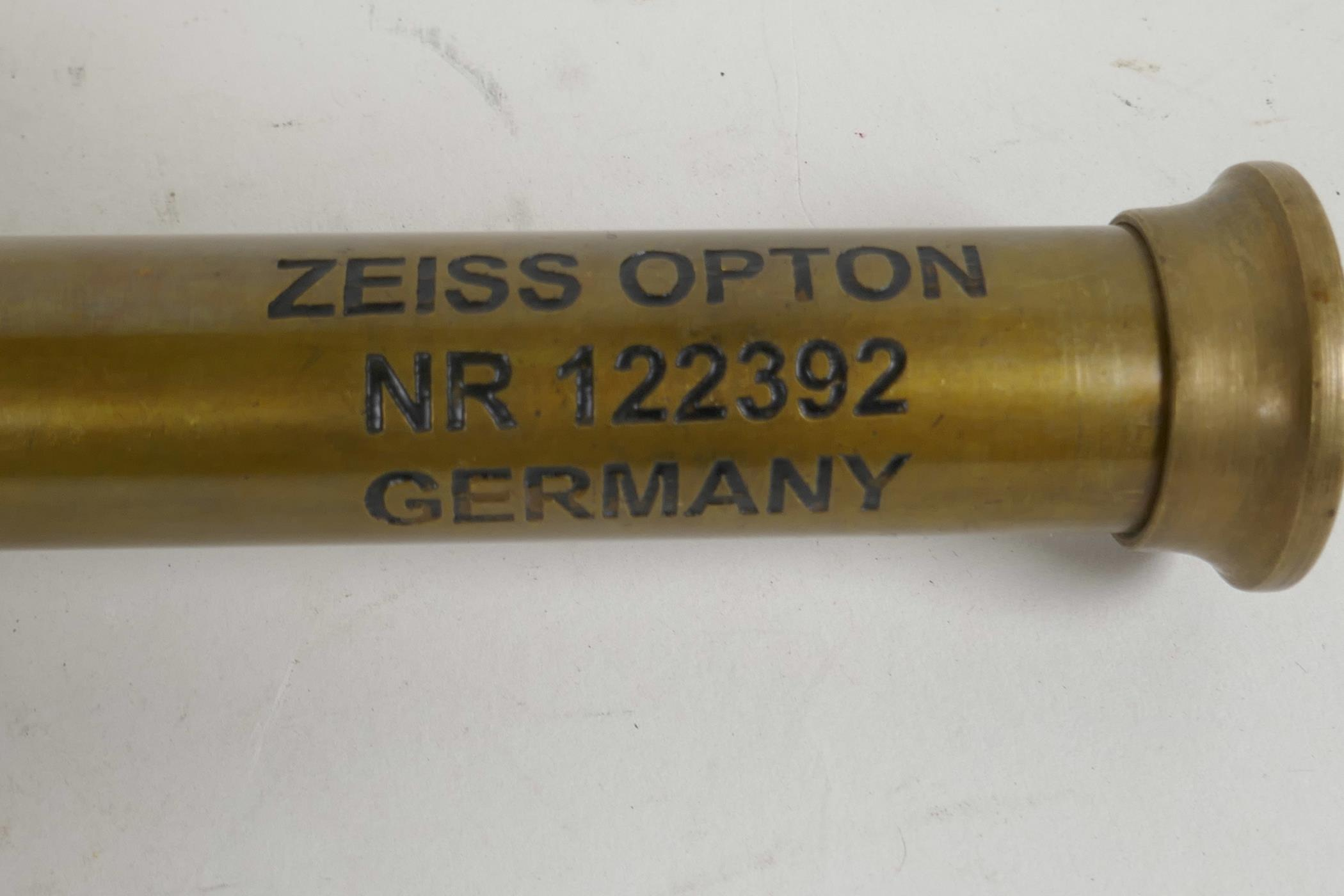 """Lot 19 - A brass cased three draw telescope marked Zeiss Germany, 6"""" long closed"""