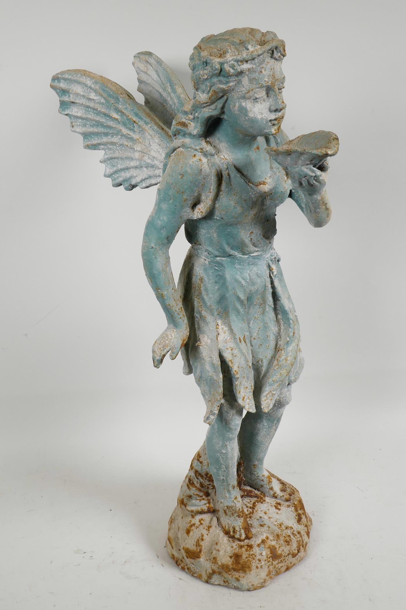 """Lot 4 - A cast iron 'fairy' garden ornament, 21"""" high"""
