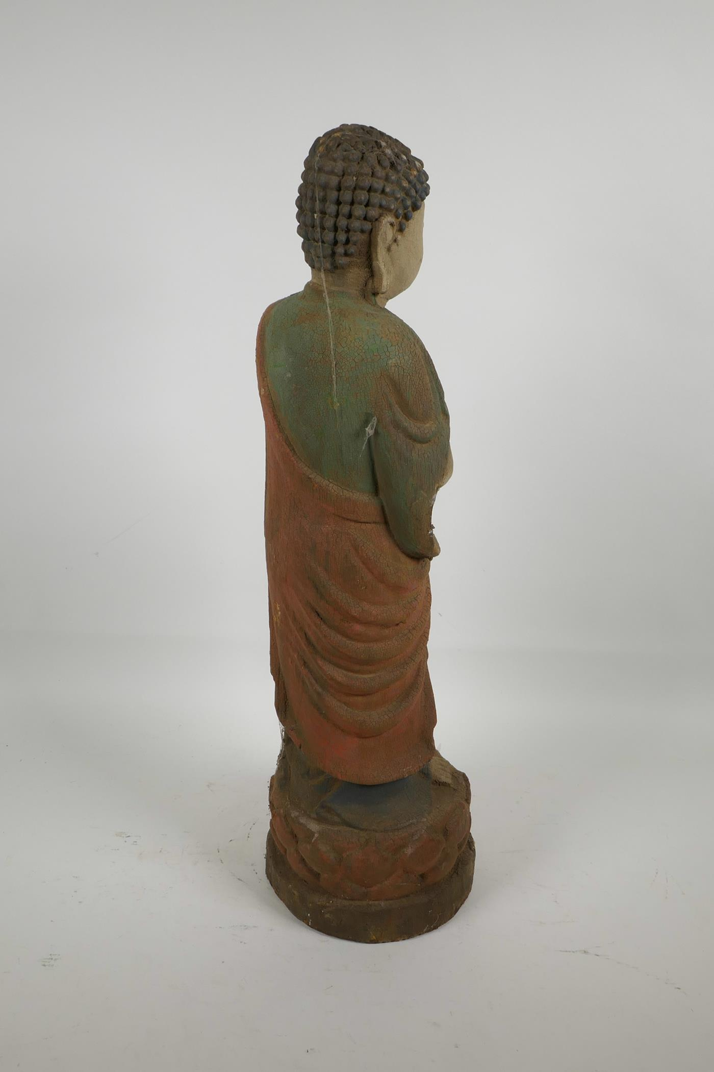 """Lot 8 - A Chinese carved wood Buddha with cracked polychrome paintwork, 22"""" high"""