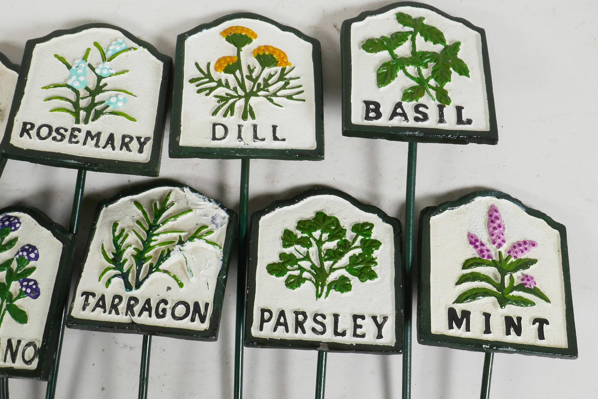 """Lot 1 - A set of twelve painted iron herb garden labels, 11½"""""""