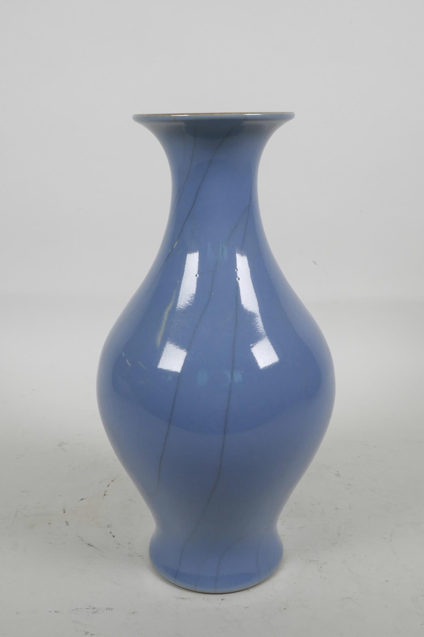 "Lot 13 - A Chinese porcelain blue glazed vase with crackle glaze decoration, 9½"" high"