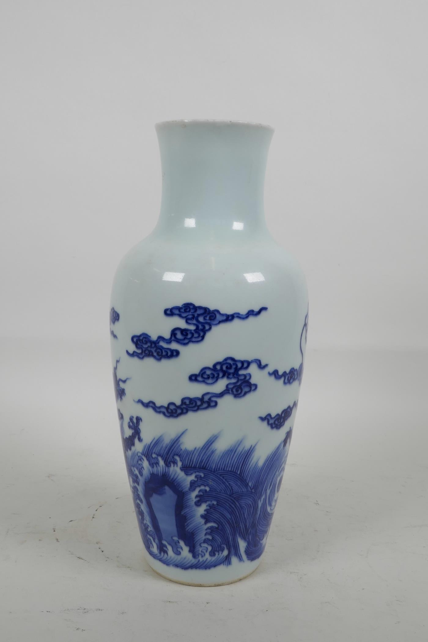 Lot 16 - A Chinese blue and white porcelain vase decorated with dragons and clouds, six character mark to