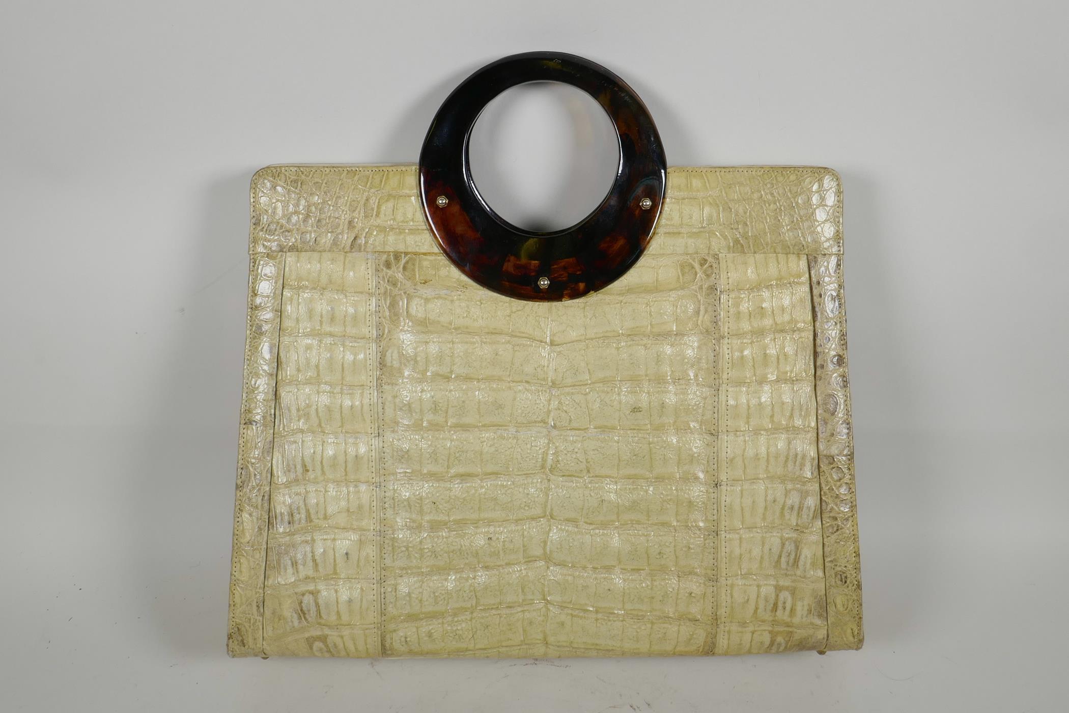 "Lot 18 - A retro crocodile skin handbag from Cape Cobra Leathercraft of Cape Town, 14½"" x 13"""