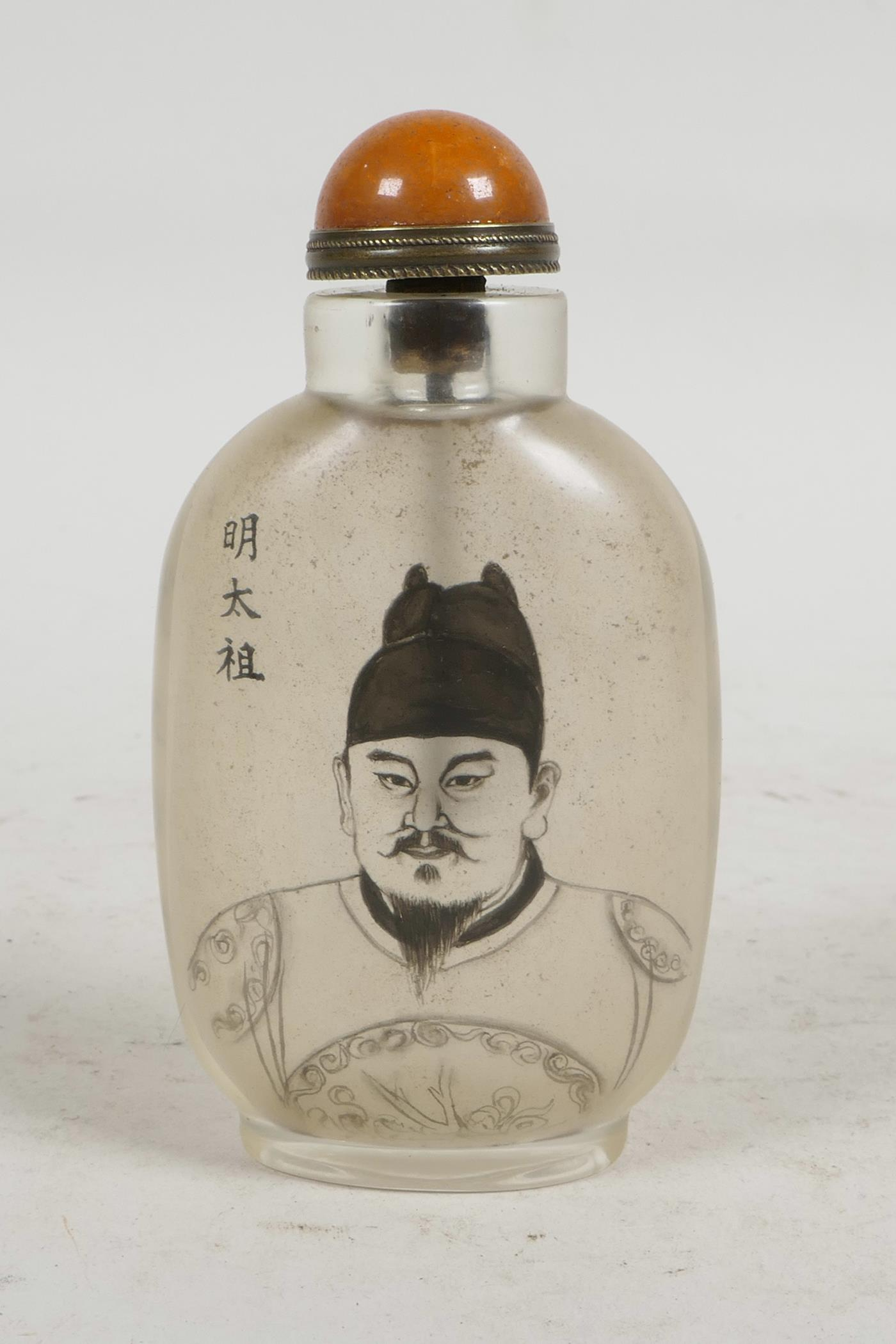 Lot 36 - A Chinese reverse decorated snuff bottle depicting a Chinese emperor, character inscription verso,