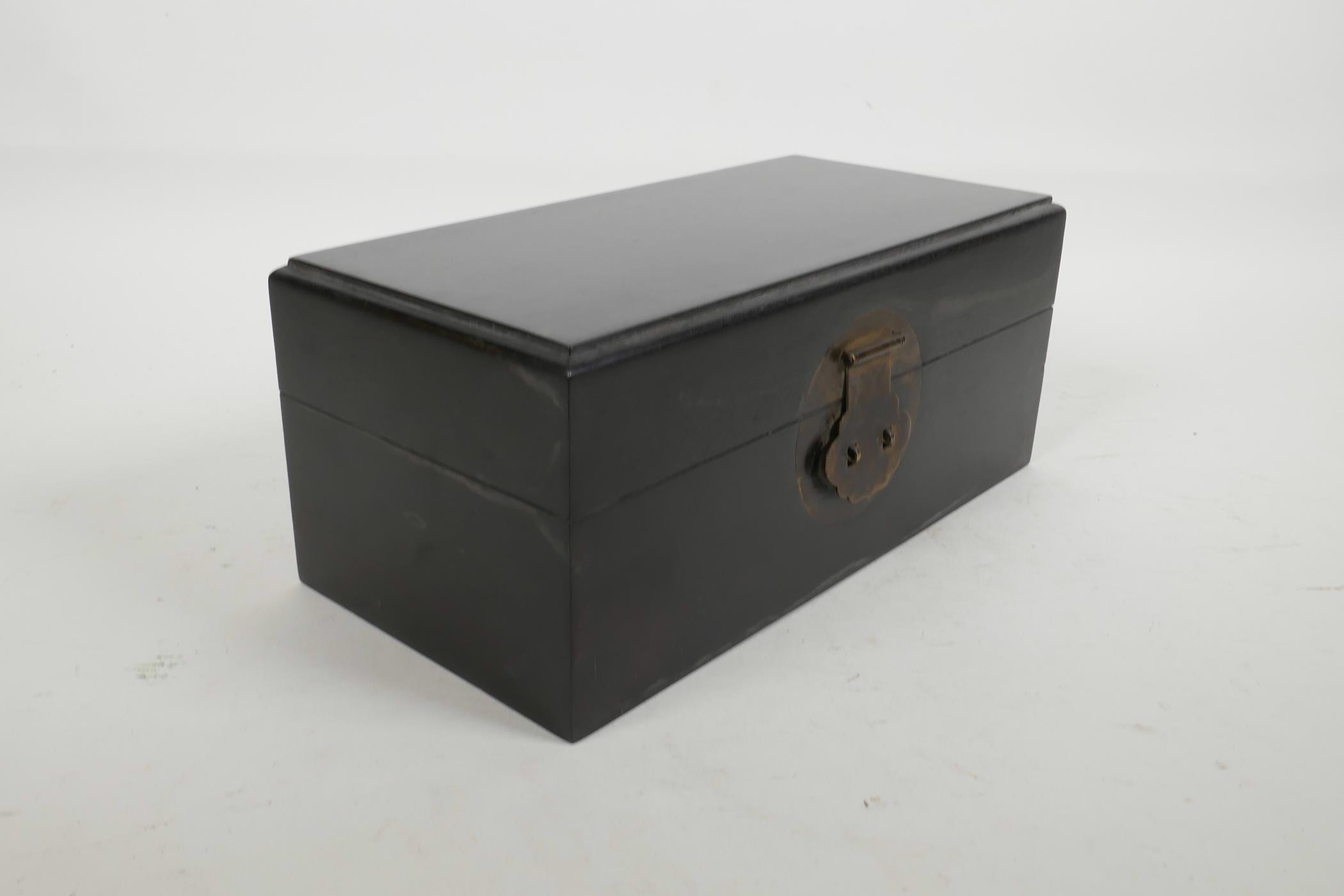 "Lot 22 - An oriental ebonised hardwood box, with brass fittings, 10"" x 5"" x 4½"""