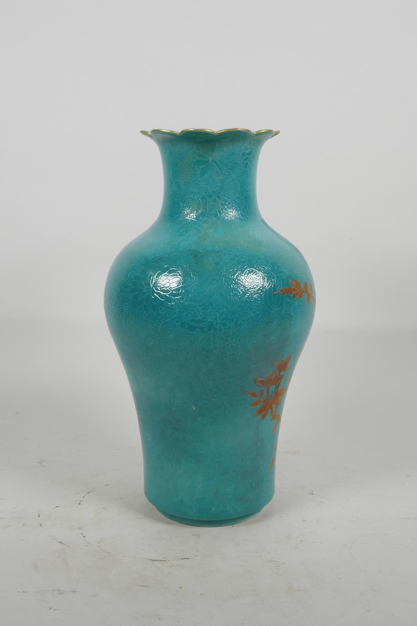 Lot 20 - A Chinese blue ground porcelain vase with incised self coloured floral decoration, overpainted