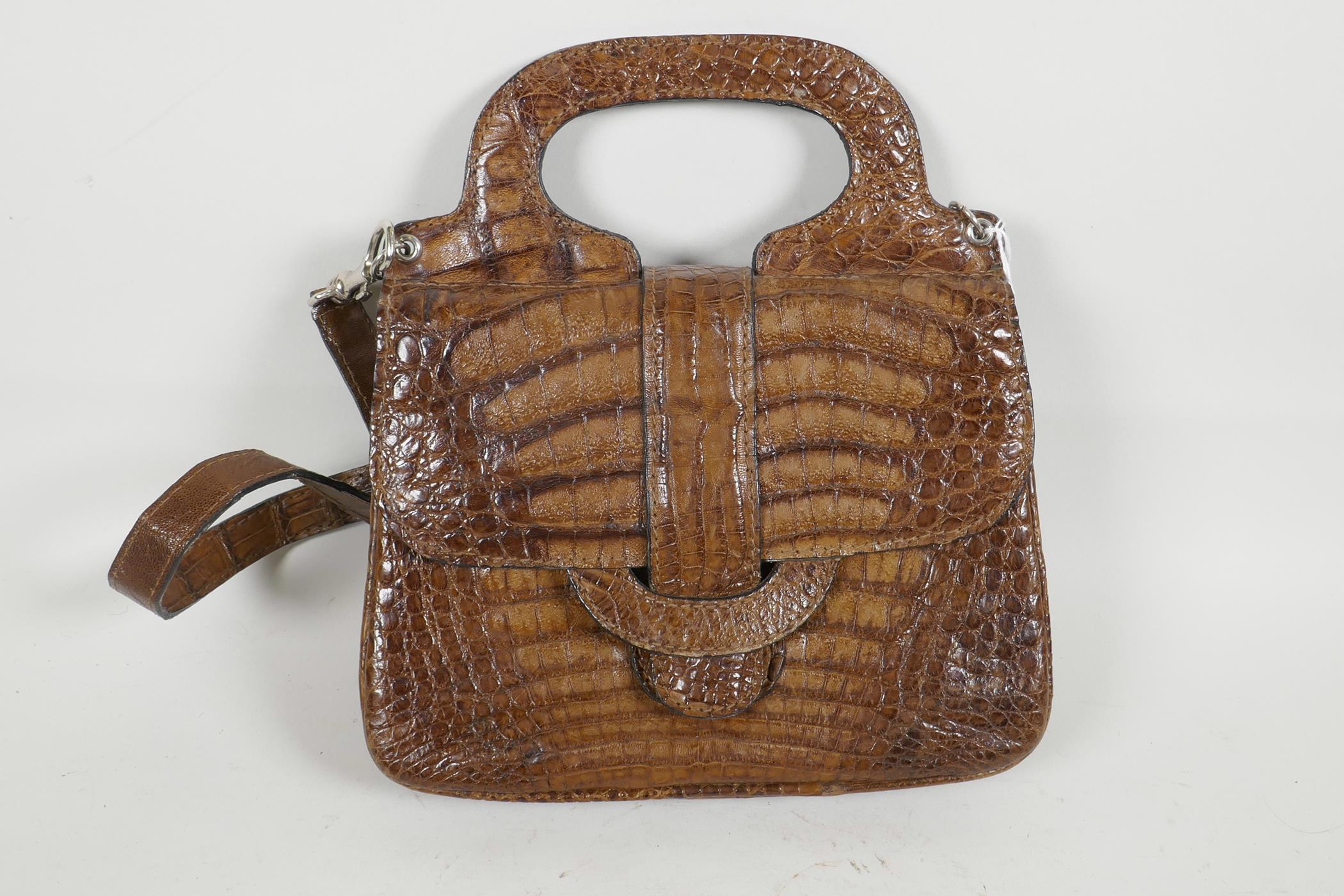 """Lot 29 - A crocodile skin handbag by Jaguar, with shoulder strap, 9½"""" x 9½"""""""