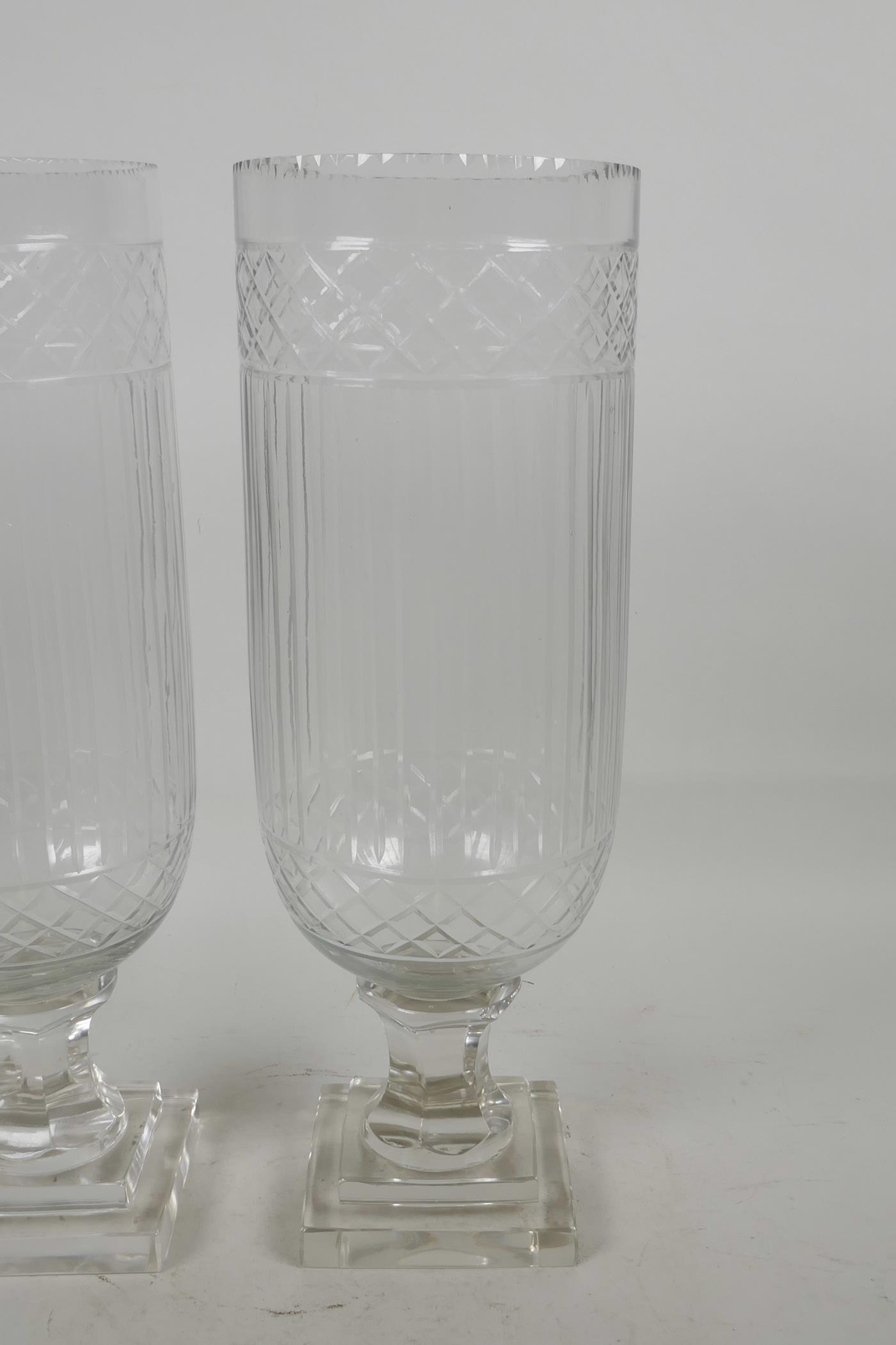 "Lot 31 - A pair of cut glass hurricane vases , 13"" high x 4½"" diameter"