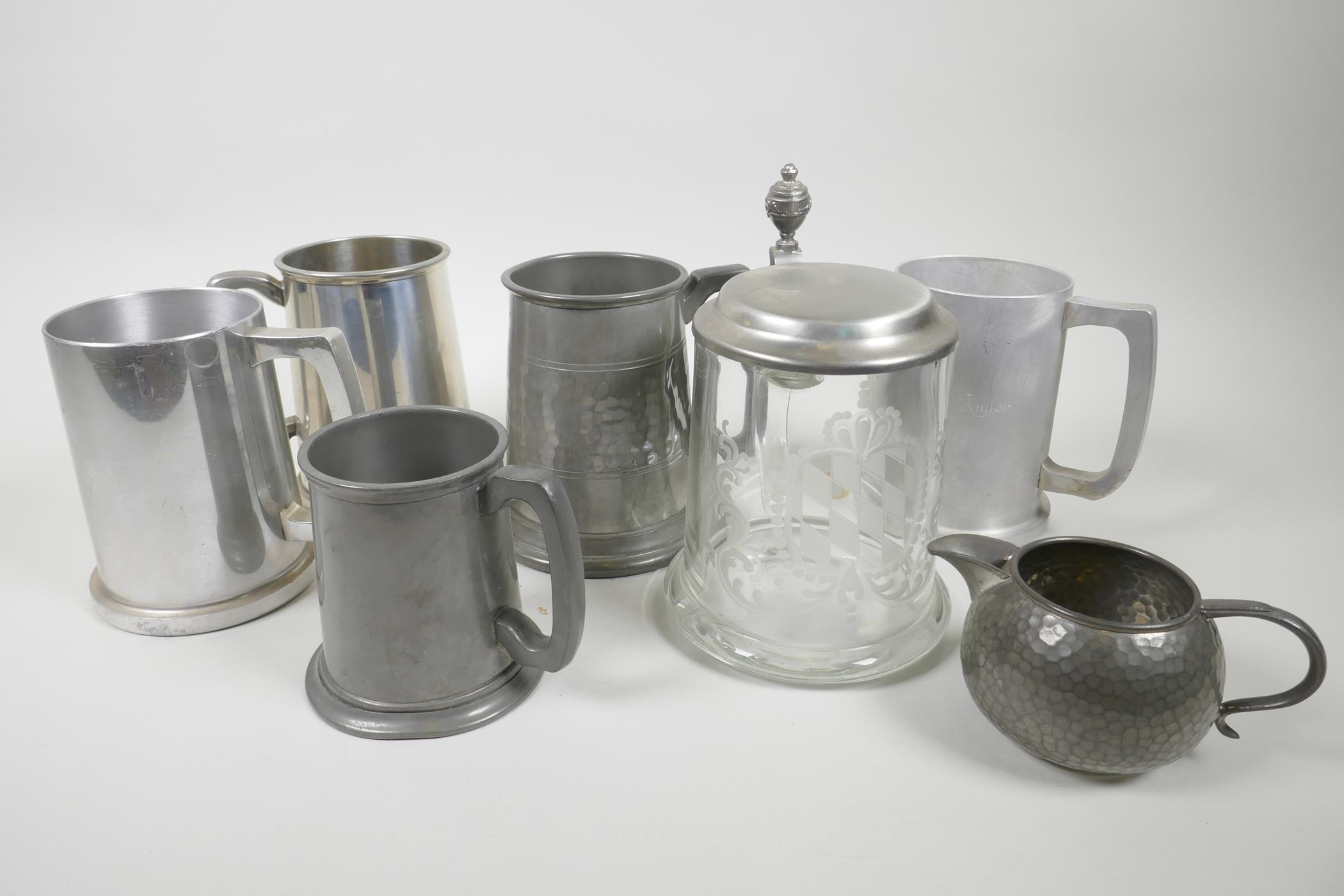 "Lot 42 - Five pewter tankards, a pewter cream jug and an engraved glass tankard with pewter lid, 6½"" high (7)"