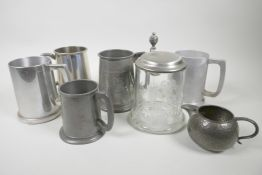 """Five pewter tankards, a pewter cream jug and an engraved glass tankard with pewter lid, 6½"""" high (7)"""