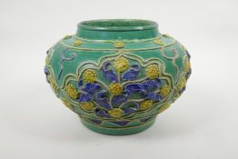 """A Chinese green ground pottery vase with raised yellow and blue floral decoration, 9"""" diameter"""