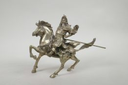 """A Chinese silvered metal figure of Guan Gong riding a horse, 7½"""" x 8"""""""