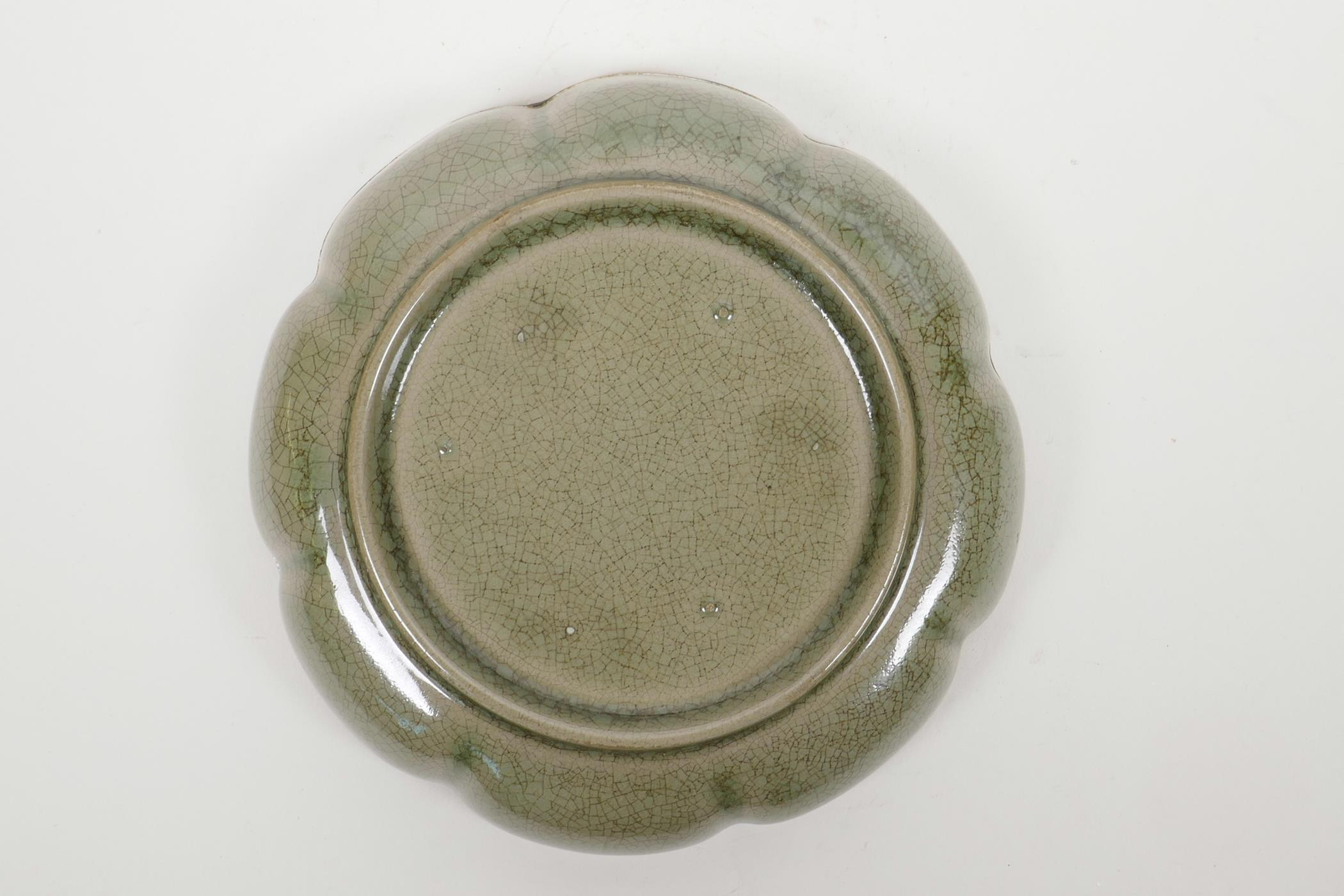 Lot 40 - A Chinese Song style olive crackle glazed bowl with a gilt metal lobed rim and incised character