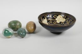 A Chinese Jian Kiln pottery bowl with floral decoration, together with four hardstone decorative