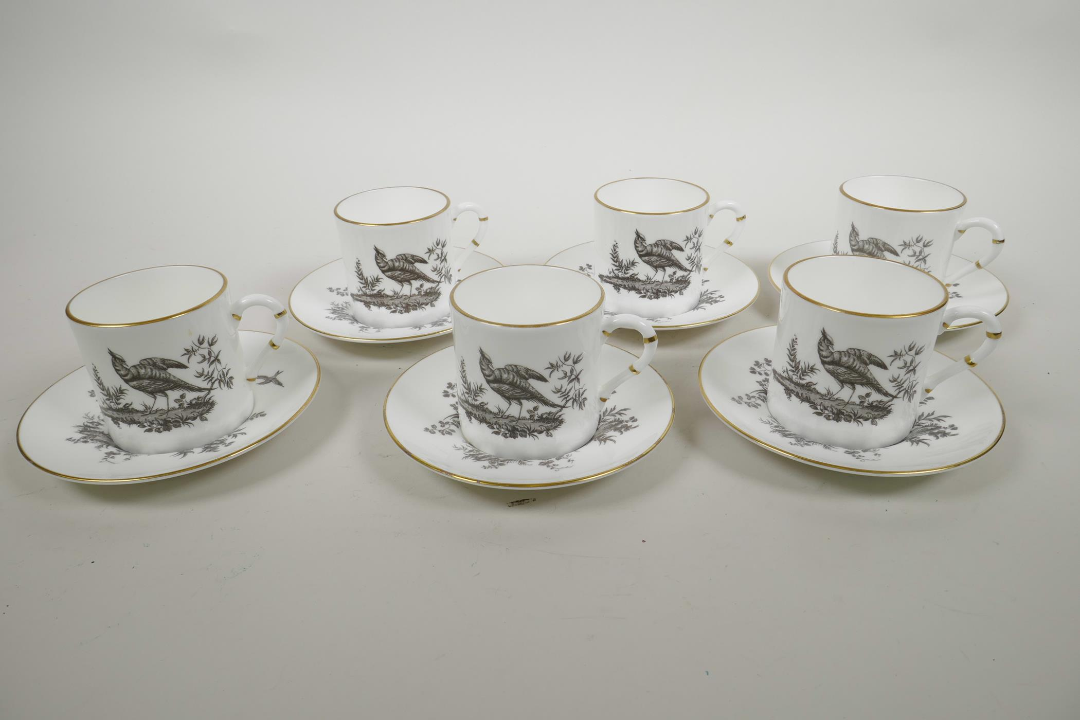 Lot 12 - A Royal Worcester porcelain coffee service comprising six cups and saucers with monochrome