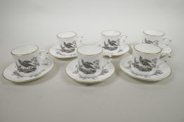A Royal Worcester porcelain coffee service comprising six cups and saucers with monochrome