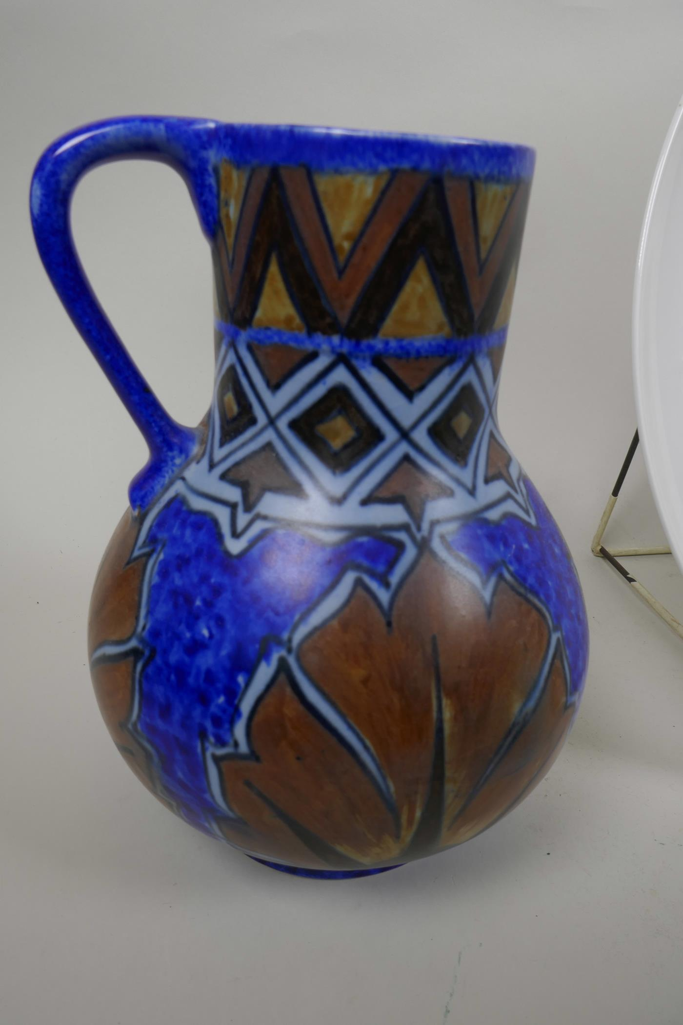Lot 52 - A Clewes Chameleon ware pottery jug with blue and brown glaze together with a Rosenthal charger