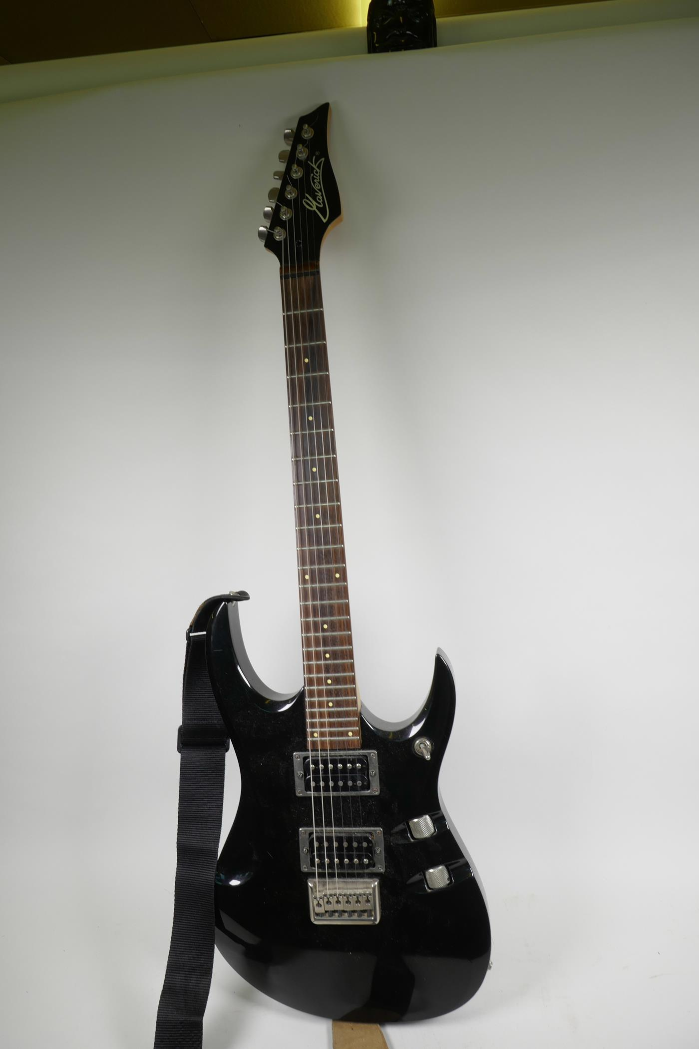 """Lot 54 - A Washburn Maverick F1-HT electric guitar with black super strat body and rosewood finger board, 40"""""""