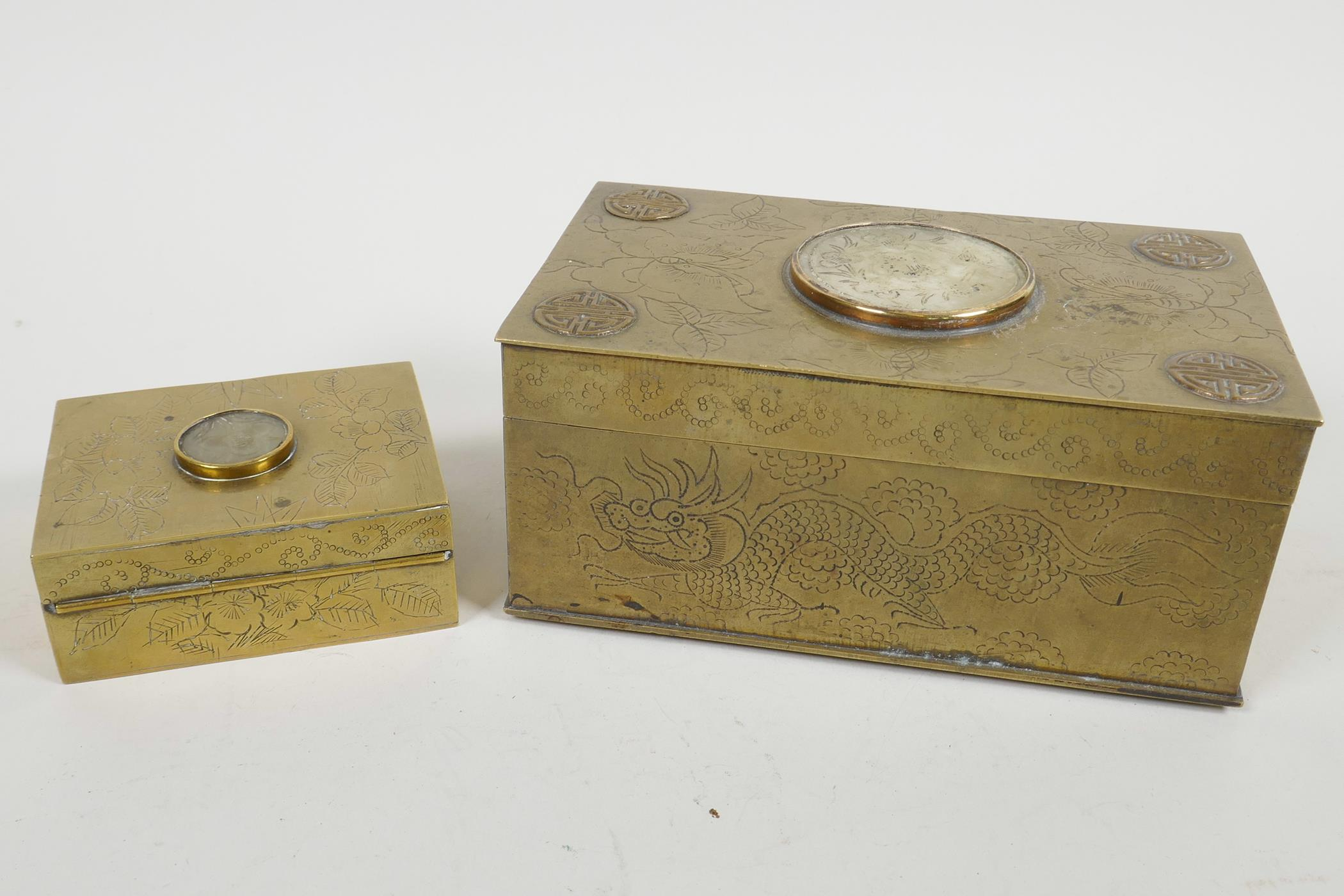 Lot 74 - A Chinese brass cased table cigarette box engraved with bats and dragons, and having applied symbols