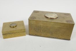 A Chinese brass cased table cigarette box engraved with bats and dragons, and having applied symbols