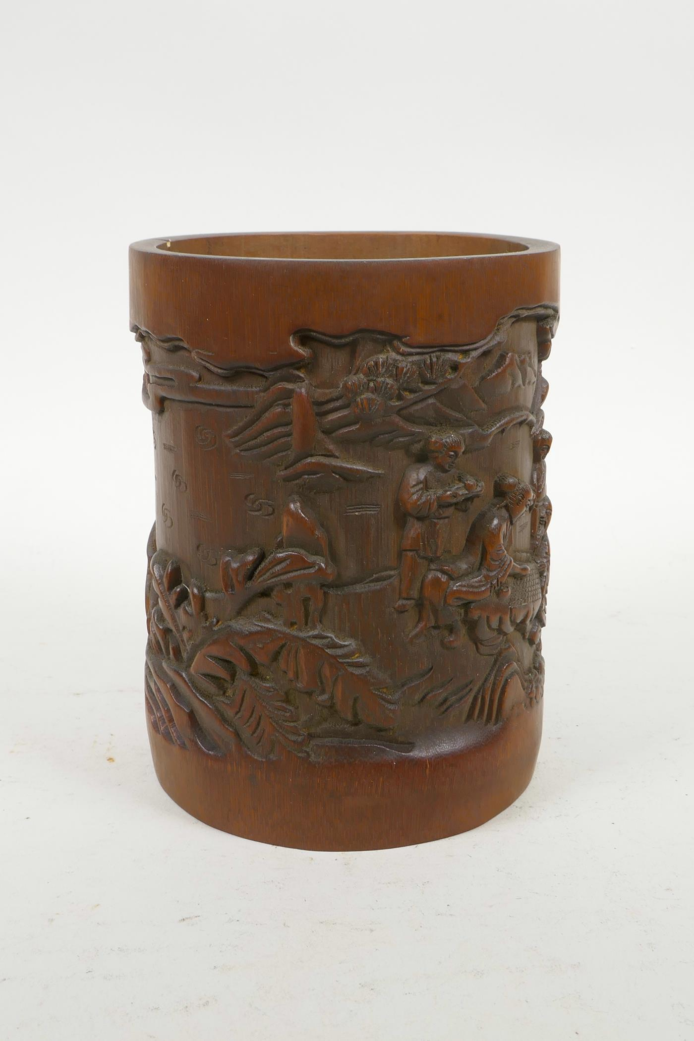 """Lot 70 - A Chinese carved bamboo brush pot decorated with figures in a landscape, 6½"""" high"""