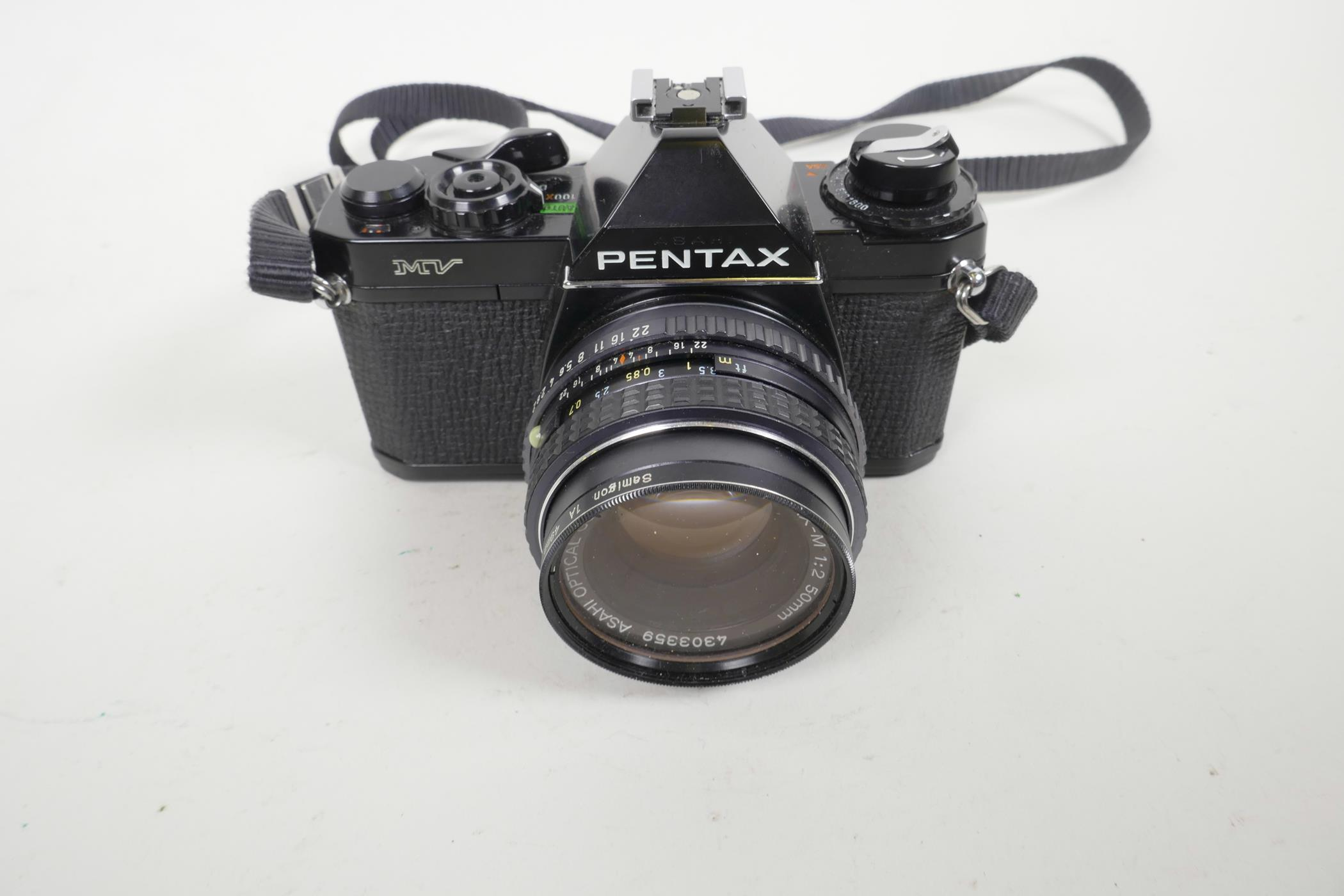 Lot 56 - A Pentax MV single lens reflex 35mm camera, together with a Pentax M 1:250 mm lens