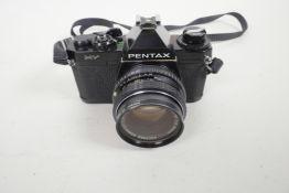 A Pentax MV single lens reflex 35mm camera, together with a Pentax M 1:250 mm lens