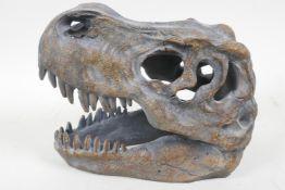 "A replica T-Rex skull, 7½"" long"