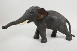 "A Japanese Meiji period bronze figure of an elephant, signed Seiya Saku, 7"" high, 13"" long"