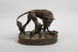 """A bronzed composition figure group of dogs, 70/200, 6"""" long, ear tips missing"""